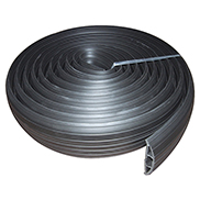 A black rubber cable floor cover protector